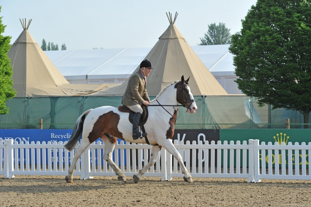 Gary Harthern riding at the Royal Windsor Horse show with Big Chief tipis in the back ground